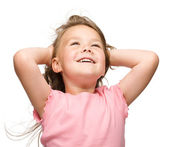 Little girl is stretching and rising hands up — Stock Photo