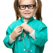 Stock Photo: Cute little girl is playing doctor