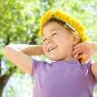 Portrait of a little girl with dandelion wreath — Stock Photo #11533492