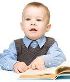 Portrait of a cute little boy with books — Stock Photo