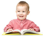 Cute little child play with book — Stock Photo