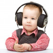 Royalty-Free Stock Photo: Cute little boy enjoying music using headphones