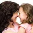 Stock Photo: Portrait of happy daughter smiling at her mother