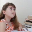 Teenage girl is doing a homework — Stockfoto