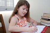 Teenage girl is doing a homework — Stock Photo
