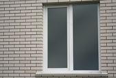 White brick wall and window — Stock Photo