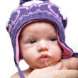 Portrait of newborn baby girl wearing violet winter hat — Stock Photo #11460310