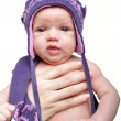Portrait of newborn baby girl wearing violet winter hat — Stock Photo #11460346