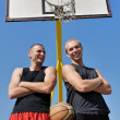 Two basketball players smiling on the court - Zdjęcie stockowe
