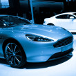 Постер, плакат: Aston Martin Virage sport car on display