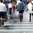 Crowd on zebra crossing street - Stock Photo