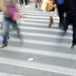Crowd on zebra crossing street — Stock Photo #11754018