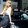 Stock Photo: Unidentified model with car