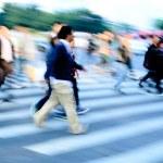 Crowd on zebra crossing street — Stock Photo #11754769