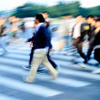 Crowd on zebra crossing street — Stock Photo #11754840