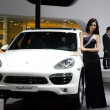 Unidentified model with Porsche Hybrid sport car — Stock Photo #11755052