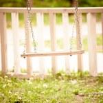 Swing in backyard — Stock Photo