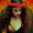 Fantasy woman with wreath of flowers — Stock Photo