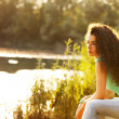 Woman sit by lake — Stock Photo