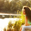 Woman sit by lake — Stock Photo #11408138