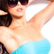 Sunglasses and bikini — Stock Photo #11473601