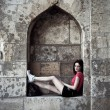 Urban girl at fortress - Stock Photo