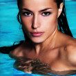 Tanned woman in water — Stock Photo #11651587