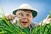 Young Man Looking through a Magnifying Glass — Stock Photo