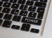 Computer keyboard - glowing power key — Stock Photo