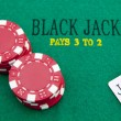 Black jack with red poker chips in background. — Stock Photo #11106250