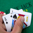 Stock Photo: Ace of hearts and black jack with red poker chips