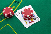 Ace of spades and black jack with red poker chips in the backgro — Stock Photo