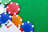 Texas holdem pocket aces on casino table with copy space and chi — Stock Photo