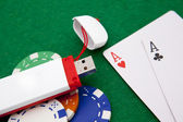 Texas holdem pocket aces on casino table with internet stick con — Stock Photo