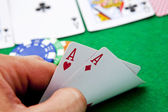 Pocket aces on a casino table — Stock Photo