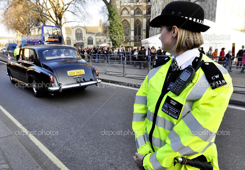 A police woman outside Westminster Abbey  Stock Photo #11576845