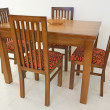 图库照片: Dining table and chairs in apartment