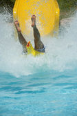 Person coming down a water slide — Stock Photo