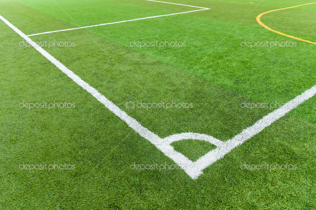 Artificial turf football field with white line corner  Stock Photo #10978293