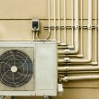 Stock Photo: Air conditioning unit sitting outside
