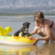 Stock Photo: Young womon beach with dog