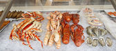 Crabs, scampi and shell fish for sale — Stock Photo
