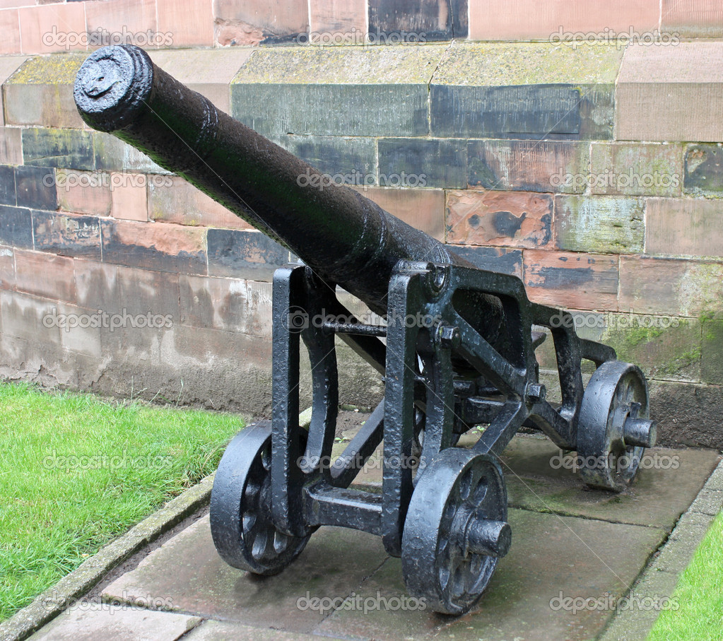 A Vintage Heavy Cannon Outside a Castle Wall. — Stock Photo #11040378