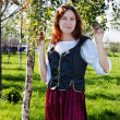 Medieval woman near the birch — Stock Photo