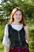 Medieval woman near the fir — Stock Photo