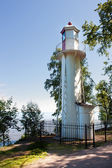 Old lighthouse on a shore — Stock Photo