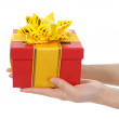 Box with a gift in the hands of women — Stock Photo