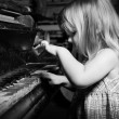 Girl playing on an piano. — Stock Photo
