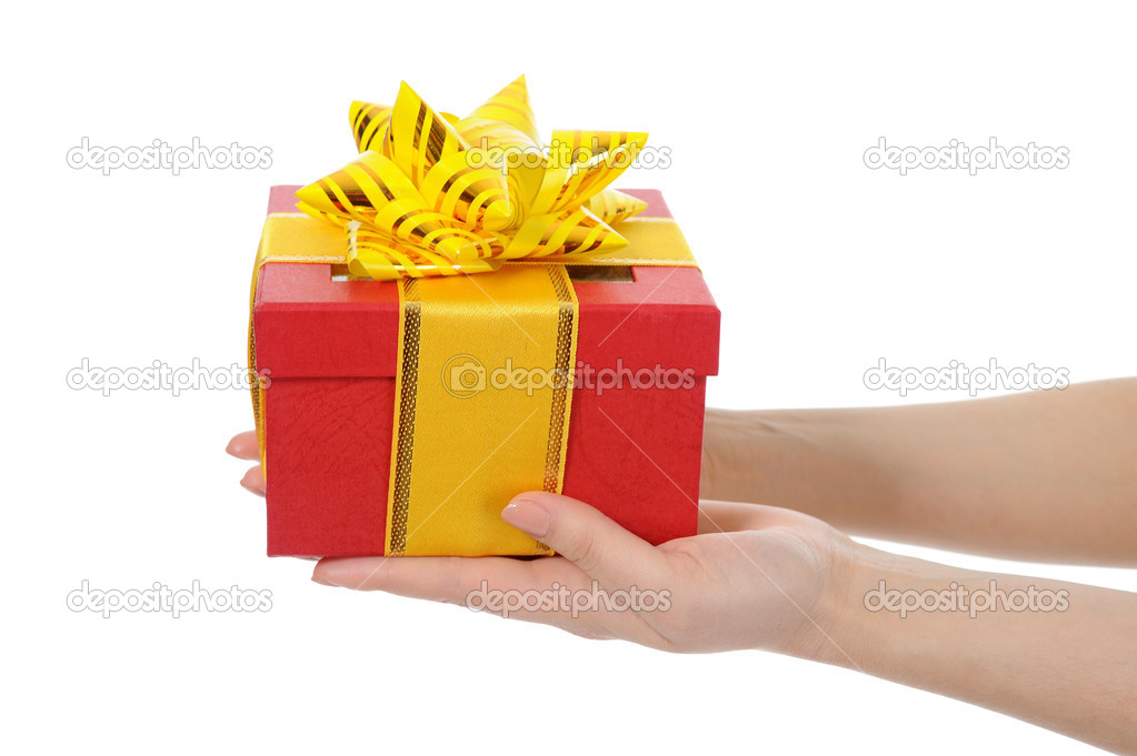 Box with a gift in the hands of women. Isolated on white background — Zdjęcie stockowe #10802118