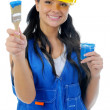 Beautiful young woman doing repairs - Stock Photo